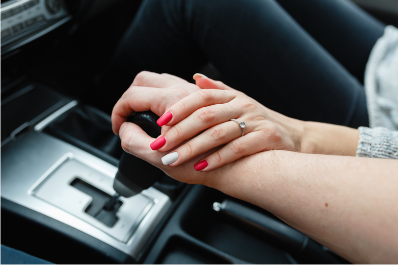 Couple Holding Hands in Nice Car